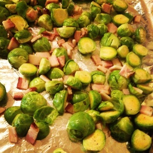 Roasted brussels sprouts & bacon bits on pan