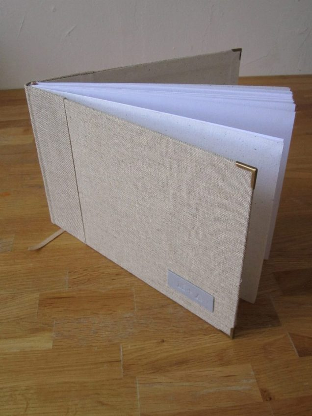 I love the simplicity of this handmade, linen book: https://www.facebook.com/media/set/?set=a.334084133291558.83291.291864014180237&type=3